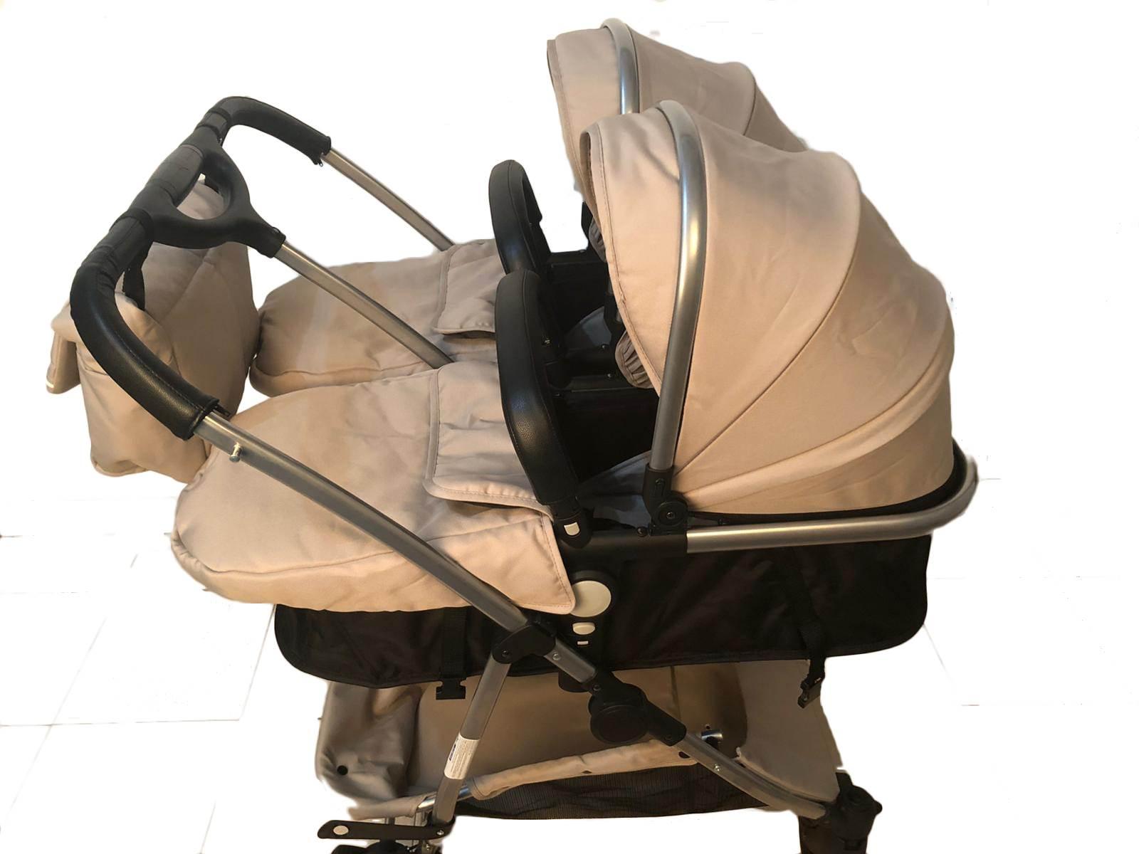 Coche gemelar capazos-sillas con bolso